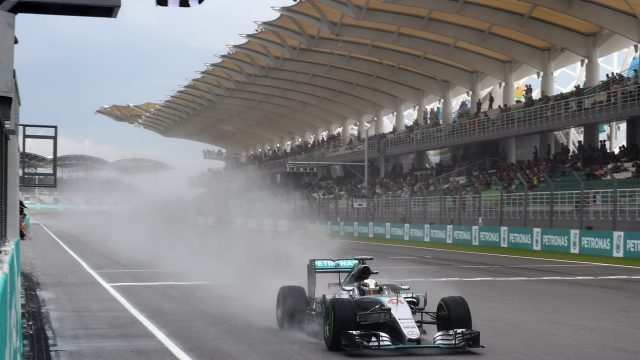 Pole sitter Lewis Hamilton (GBR) Mercedes AMG F1 W06 takes the chequered flag at Formula One World Championship, Rd2, Malaysian Grand Prix, Qualifying, Sepang, Malaysia, Saturday 28  March 2015. &copy&#x3b; Sutton Motorsport Images