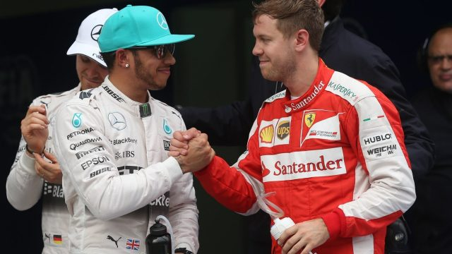 Congratulation for taking pole position to Lewis Hamilton (GBR) Mercedes AMG F1 from Sebastian Vettel (GER) Ferrari at Formula One World Championship, Rd2, Malaysian Grand Prix, Qualifying, Sepang, Malaysia, Saturday 28  March 2015. &copy&#x3b; Sutton Motorsport Images