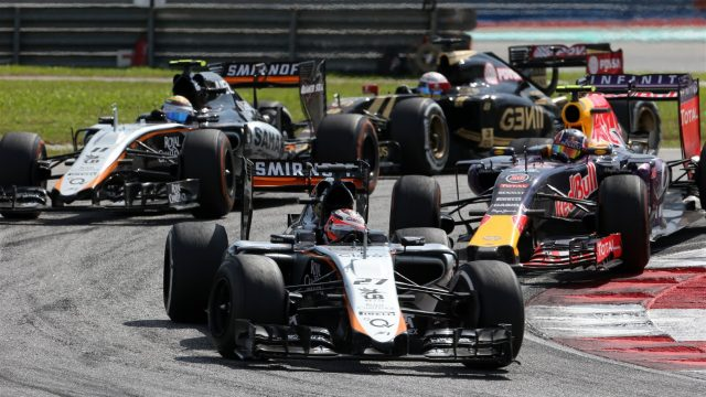 Nico Hulkenberg (GER) Force India VJM08 leads Daniil Kvyat (RUS) Red Bull Racing RB11 at Formula One World Championship, Rd2, Malaysian Grand Prix, Race, Sepang, Malaysia, Sunday 29 March 2015. &copy&#x3b; Sutton Motorsport Images