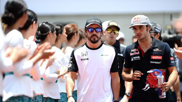 Fernando Alonso (ESP) McLaren and Carlos Sainz jr (ESP) Scuderia Toro Rosso on the drivers parade at Formula One World Championship, Rd2, Malaysian Grand Prix, Race, Sepang, Malaysia, Sunday 29 March 2015. &copy&#x3b; Sutton Motorsport Images