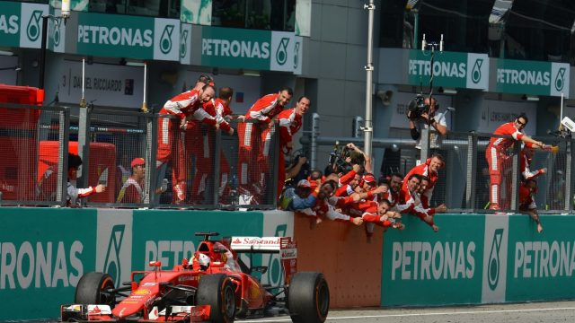 Race winner Sebastian Vettel (GER) Ferrari SF15-T crosses the line at Formula One World Championship, Rd2, Malaysian Grand Prix, Race, Sepang, Malaysia, Sunday 29 March 2015. &copy&#x3b; Sutton Motorsport Images