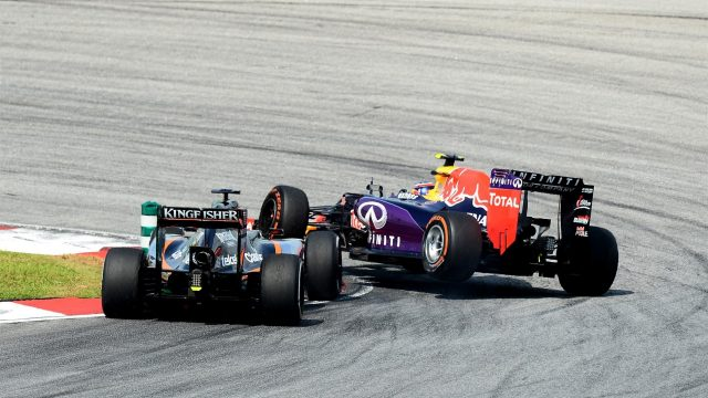 Nico Hulkenberg (GER) Force India VJM08 and Daniil Kvyat (RUS) Red Bull Racing RB11 come together at Formula One World Championship, Rd2, Malaysian Grand Prix, Race, Sepang, Malaysia, Sunday 29 March 2015. &copy&#x3b; Sutton Motorsport Images