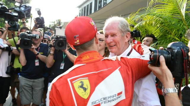 Sebastian Vettel (GER) Ferrari and Dr Helmut Marko (AUT) Red Bull Motorsport Consultant at Formula One World Championship, Rd2, Malaysian Grand Prix, Race, Sepang, Malaysia, Sunday 29 March 2015. &copy&#x3b; Sutton Motorsport Images