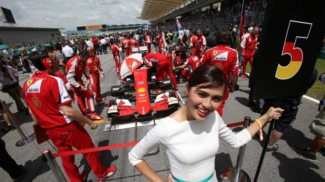 Sebastian Vettel (GER) Ferrari SF15-T and grid girl on the grid at Formula One World Championship, Rd2, Malaysian Grand Prix, Race, Sepang, Malaysia, Sunday 29 March 2015. &copy&#x3b; Sutton Motorsport Images