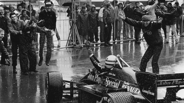 Ayrton Senna (Lotus 97T-Renault) celebrates 1st position with Team Manager Peter Warr (right) in parc ferme. Note Kenny Szymanski looking 'like he's pogoing'. Copyright: LAT Photographic.