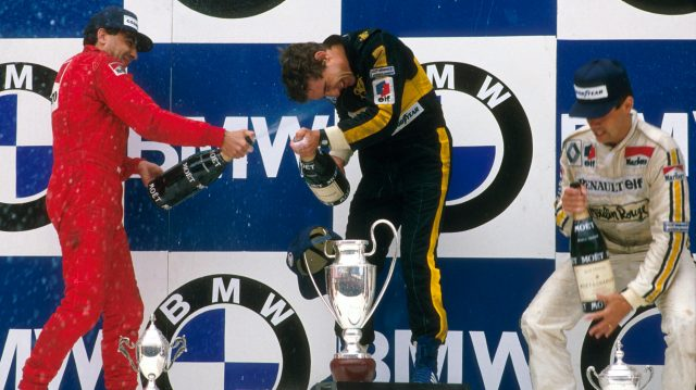 Ayrton Senna (Team Lotus) 1st position, Michele Alboreto (Ferrari) 2nd position and Patrick Tambay (Equipe Renault) 3rd position on the podium. Copyright - LAT Photographic
