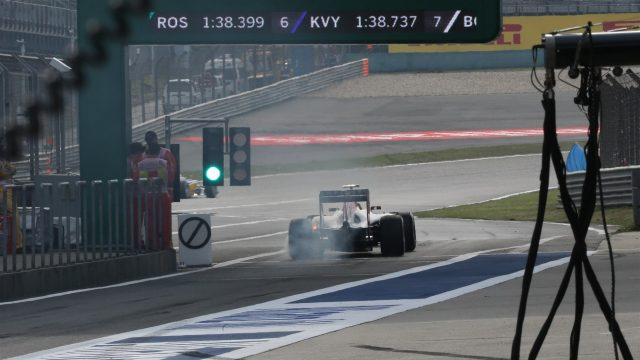 Daniil Kvyat (RUS) Red Bull Racing RB11 exits pit lane with his rear brakes on fire at Formula One World Championship, Rd3, Chinese Grand Prix, Practice, Shanghai, China, Friday 10 April 2015. &copy&#x3b; Sutton Motorsport Images