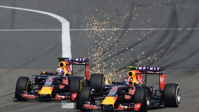 Daniel Ricciardo (AUS) Red Bull Racing RB11 AND Daniil Kvyat (RUS) Red Bull Racing RB11 BATTLE  at the start of the race at Formula One World Championship, Rd3, Chinese Grand Prix, Race, Shanghai, China, Sunday 12 April 2015. &copy&#x3b; Sutton Motorsport Images