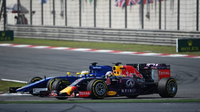 Marcus Ericsson (SWE) Sauber C34 and Daniel Ricciardo (AUS) Red Bull Racing RB11 battle at Formula One World Championship, Rd3, Chinese Grand Prix, Race, Shanghai, China, Sunday 12 April 2015. &copy&#x3b; Sutton Motorsport Images