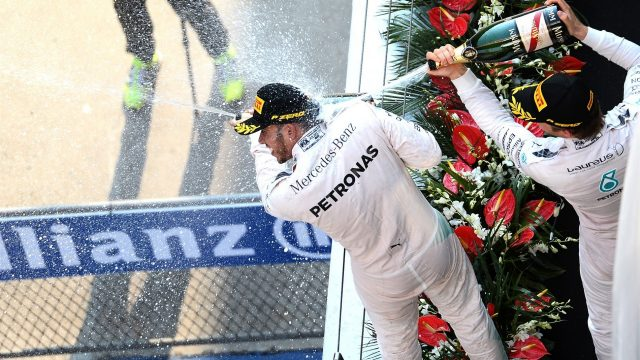 Lewis Hamilton (GBR) Mercedes AMG F1 and Nico Rosberg (GER) Mercedes AMG F1 celebrate with the champagne on the podium at Formula One World Championship, Rd3, Chinese Grand Prix, Race, Shanghai, China, Sunday 12 April 2015. &copy&#x3b; Sutton Motorsport Images