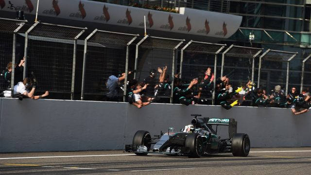 Race winner Lewis Hamilton (GBR) Mercedes AMG F1 W06 crosses the line and passes his team at Formula One World Championship, Rd3, Chinese Grand Prix, Race, Shanghai, China, Sunday 12 April 2015. &copy&#x3b; Sutton Motorsport Images