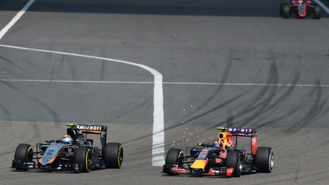 Sergio Perez (MEX) Force India VJM08 and Daniil Kvyat (RUS) Red Bull Racing RB11 at Formula One World Championship, Rd3, Chinese Grand Prix, Race, Shanghai, China, Sunday 12 April 2015. &copy&#x3b; Sutton Motorsport Images