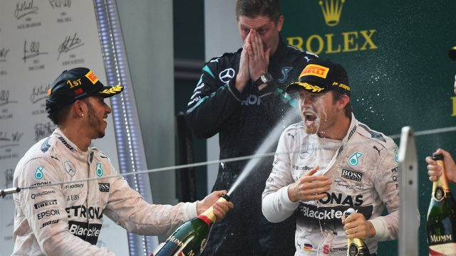 Lewis Hamilton (GBR) Mercedes AMG F1 and Nico Rosberg (GER) Mercedes AMG F1 celebrate on the podium with the champagne Formula One World Championship, Rd3, Chinese Grand Prix, Race, Shanghai, China, Sunday 12 April 2015. &copy&#x3b; Sutton Motorsport Images