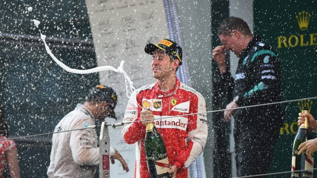 Sebastian Vettel (GER) Ferrari celebrates on the podium with the champagne at Formula One World Championship, Rd3, Chinese Grand Prix, Race, Shanghai, China, Sunday 12 April 2015. &copy&#x3b; Sutton Motorsport Images