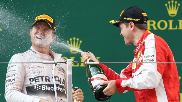 Sebastian Vettel (GER) Ferrari celebrates with Nico Rosberg (GER) Mercedes AMG F1 and champagne on the podium at Formula One World Championship, Rd3, Chinese Grand Prix, Race, Shanghai, China, Sunday 12 April 2015. &copy&#x3b; Sutton Motorsport Images
