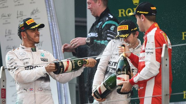 Nico Rosberg (GER) Mercedes AMG F1, Lewis Hamilton (GBR) Mercedes AMG F1 and Sebastian Vettel (GER) Ferrari celebrate on the podium with champagne at Formula One World Championship, Rd3, Chinese Grand Prix, Race, Shanghai, China, Sunday 12 April 2015. &copy&#x3b; Sutton Motorsport Images