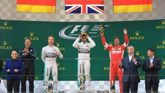 (L to R): Nico Rosberg (GER) Mercedes AMG F1, race winner Lewis Hamilton (GBR) Mercedes AMG F1 and Sebastian Vettel (GER) Ferrari celebrate on the podium at Formula One World Championship, Rd3, Chinese Grand Prix, Race, Shanghai, China, Sunday 12 April 2015. &copy&#x3b; Sutton Motorsport Images