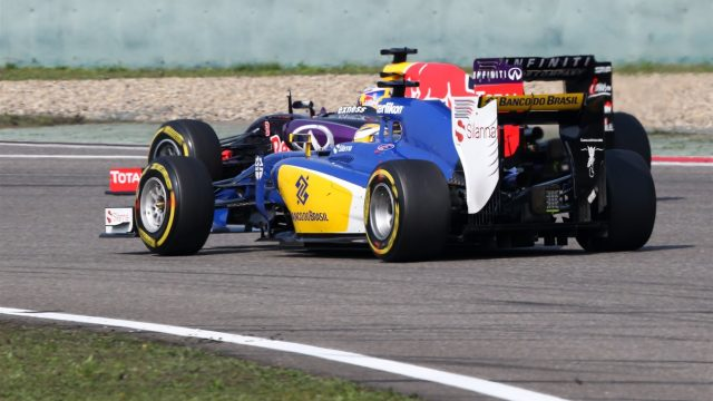 Daniel Ricciardo (AUS) Red Bull Racing RB11 and Marcus Ericsson (SWE) Sauber C34 battle at Formula One World Championship, Rd3, Chinese Grand Prix, Race, Shanghai, China, Sunday 12 April 2015. &copy&#x3b; Sutton Motorsport Images