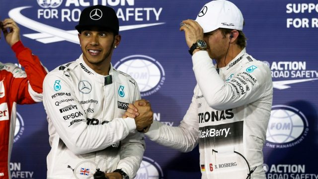(L to R): Pole sitter Lewis Hamilton (GBR) Mercedes AMG F1 and Nico Rosberg (GER) Mercedes AMG F1 celebrate in parc ferme at Formula One World Championship, Rd4, Bahrain Grand Prix Qualifying, Bahrain International Circuit, Sakhir, Bahrain, Saturday 18  April 2015. &copy&#x3b; Sutton Motorsport Images