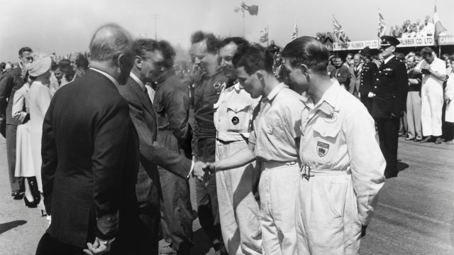 King George VI meets the drivers, including a young Stirling Moss, who finished in 2nd position in the 500cc support race. Silverstone, Great Britain. 13th May 1950.