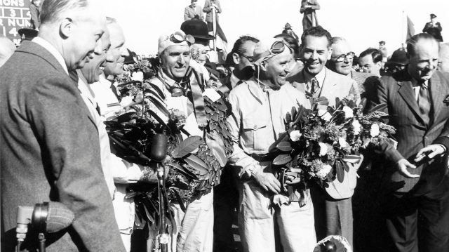 Giuseppe Farina and Luigi Fagioli on the podium. 1950 British Grand Prix