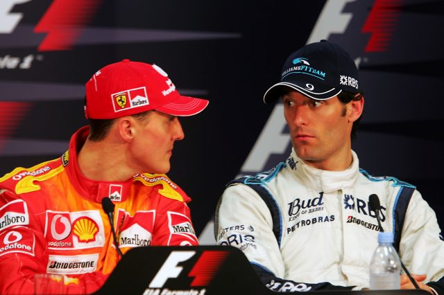 (L to R): Pole sitter Michael Schumacher (GER) Ferrari talks with Mark Webber (AUS) Williams in the FIA Press Conference.