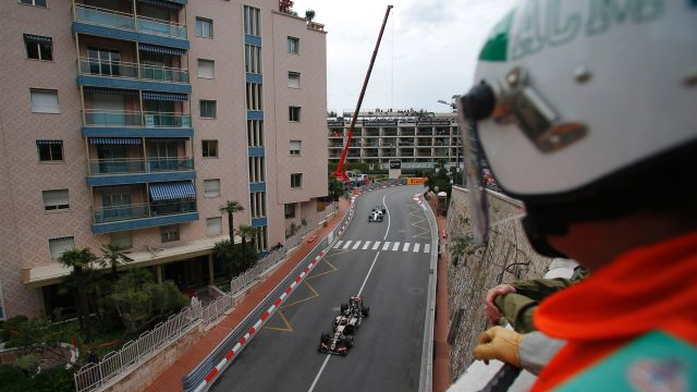 Marshal watches Romain Grosjean (FRA) Lotus E23 Hybrid at Formula One World Championship, Rd6, Monaco Grand Prix Practice, Monte-Carlo, Monaco, Thursday 21  May 2015. &copy&#x3b; Sutton Motorsport Images