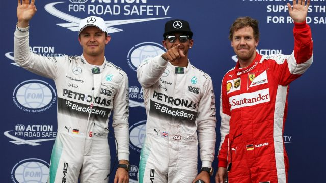 (L to R): Nico Rosberg (GER) Mercedes AMG F1 pole sitter Lewis Hamilton (GBR) Mercedes AMG F1 and Sebastian Vettel (GER) Ferrari celebrate in parc ferme at Formula One World Championship, Rd6, Monaco Grand Prix Qualifying, Monte-Carlo, Monaco, Saturday 23 May 2015. &copy&#x3b; Sutton Motorsport Images