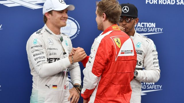 Nico Rosberg (GER) Mercedes AMG F1 and Sebastian Vettel (GER) Ferrari celebrate in parc ferme with Lewis Hamilton (GBR) Mercedes AMG F1 at Formula One World Championship, Rd6, Monaco Grand Prix Qualifying, Monte-Carlo, Monaco, Saturday 23 May 2015. &copy&#x3b; Sutton Motorsport Images
