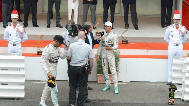 Lewis Hamilton (GBR) Mercedes AMG F1 after the podium as Nico Rosberg (GER) Mercedes AMG F1 talks with Martin Brundle (GBR) Sky TV at Formula One World Championship, Rd6, Monaco Grand Prix Race, Monte-Carlo, Monaco, Sunday 24 May 2015. &copy&#x3b; Sutton Motorsport Images