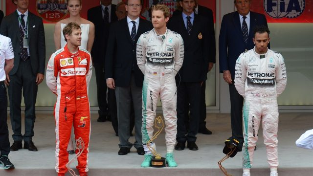 Sebastian Vettel (GER) Ferrari, Nico Rosberg (GER) Mercedes AMG F1 and Lewis Hamilton (GBR) Mercedes AMG F1 on the podium at Formula One World Championship, Rd6, Monaco Grand Prix Race, Monte-Carlo, Monaco, Sunday 24 May 2015. &copy&#x3b; Sutton Motorsport Images