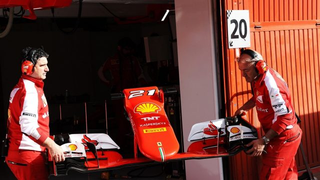 Ferrari mechanics with Ferrari SF15-T front wing at Formula One Testing, Day Two, Barcelona, Spain, 13 May 2015. &copy&#x3b; Sutton Motorsport Images
