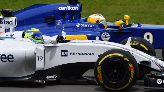 Felipe Massa (BRA) Williams FW37 and Marcus Ericsson (SWE) Sauber C34 battle at Formula One World Championship, Rd7, Canadian Grand Prix, Race, Montreal, Canada, Sunday 7 June 2015. &copy&#x3b; Sutton Motorsport Images