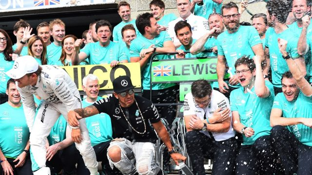 Race winner Lewis Hamilton (GBR) Mercedes AMG F1 and second placed Nico Rosberg (GER) Mercedes AMG F1 celebrate with the team at Formula One World Championship, Rd7, Canadian Grand Prix, Race, Montreal, Canada, Sunday 7 June 2015. &copy&#x3b; Sutton Motorsport Images