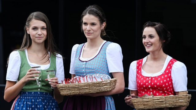Formula Unas girls serving traditional food in the paddock at Formula One World Championship, Rd8, Austrian Grand Prix, Preparations, Spielberg, Austria, Thursday 18 June 2015. &copy&#x3b; Sutton Motorsport Images