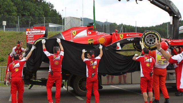 The car of Sebastian Vettel (GER) Ferrari SF15-T is recovered after stopping on track in FP1 at Formula One World Championship, Rd8, Austrian Grand Prix, Practice, Spielberg, Austria, Friday 19 June 2015. &copy&#x3b; Sutton Motorsport Images