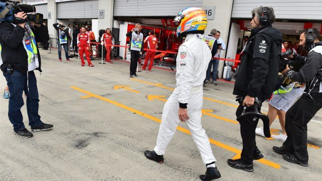 Fernando Alonso (ESP) McLaren walks in after stopping on track in FP3 at Formula One World Championship, Rd8, Austrian Grand Prix, Qualifying, Spielberg, Austria, Saturday 20 June 2015. &copy&#x3b; Sutton Motorsport Images