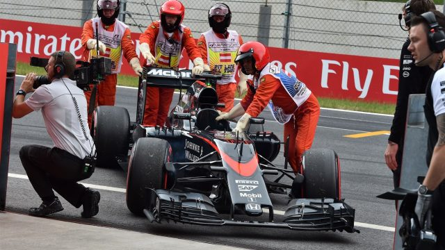 The car of Fernando Alonso (ESP) McLaren MP4-30 is recovered after stopping on track in FP3 at Formula One World Championship, Rd8, Austrian Grand Prix, Qualifying, Spielberg, Austria, Saturday 20 June 2015. &copy&#x3b; Sutton Motorsport Images