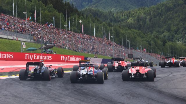 Jenson Button (GBR) McLaren MP4-30, Daniel Ricciardo (AUS) Red Bull Racing RB11 and Will Stevens (GBR) Manor GP at the start of the race at Formula One World Championship, Rd8, Austrian Grand Prix, Race, Spielberg, Austria, Sunday 21 June 2015. &copy&#x3b; Sutton Motorsport Images