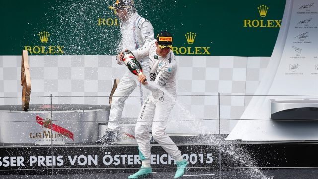 Race winner Nico Rosberg (GER) Mercedes AMG F1 celebrates with Lewis Hamilton (GBR) Mercedes AMG F1 and champagne on the podium at Formula One World Championship, Rd8, Austrian Grand Prix, Race, Spielberg, Austria, Sunday 21 June 2015. &copy&#x3b; Sutton Motorsport Images