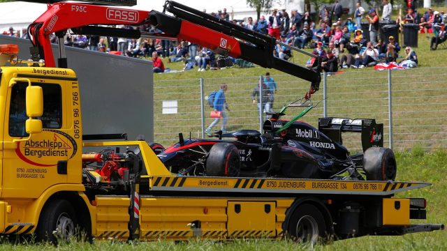 The car of race retiree Fernando Alonso (ESP) McLaren MP4-30 is recovered at Formula One World Championship, Rd8, Austrian Grand Prix, Race, Spielberg, Austria, Sunday 21 June 2015. &copy&#x3b; Sutton Motorsport Images