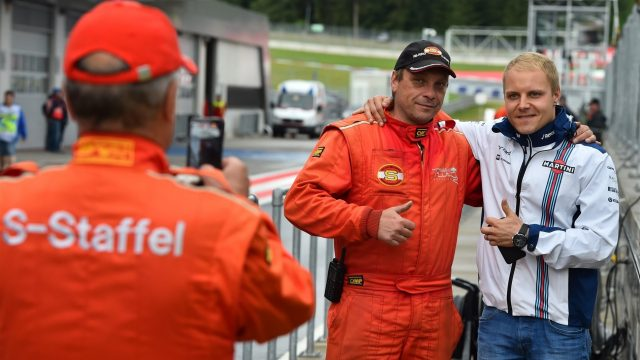 Valtteri Bottas (FIN) Williams poses for a photo with a marshal at Formula One Testing, Day One, Spielberg, Austria, Tuesday 23 June 2015. &copy&#x3b; Sutton Motorsport Images