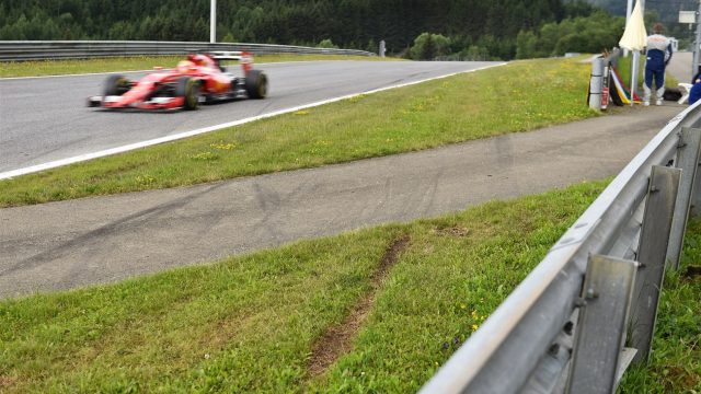 Esteban Gutierrez (MEX) Ferrari Test and Reserve Driver drives past the incident area with tyre marks in the grass from last weeks Austrian Grand Prix race at Formula One Testing, Day Two, Spielberg, Austria, Wednesday 24 June 2015. &copy&#x3b; Sutton Motorsport Images