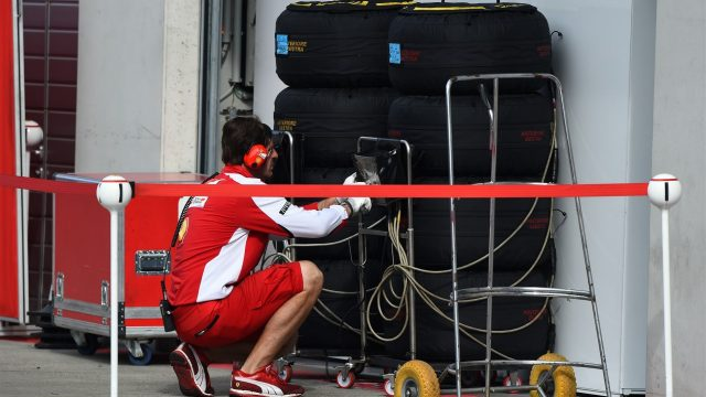 Ferrari mechanic with Pirelli tyres at Formula One Testing, Day Two, Spielberg, Austria, Wednesday 24 June 2015. &copy&#x3b; Sutton Motorsport Images