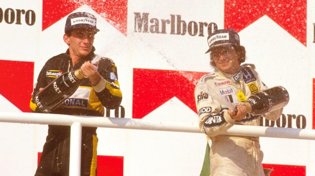 Nelson Piquet (Williams Honda) 1st position with Ayrton Senna (Team Lotus) 2nd position on the podium. Hungaroring, Budapest, Hungary.
