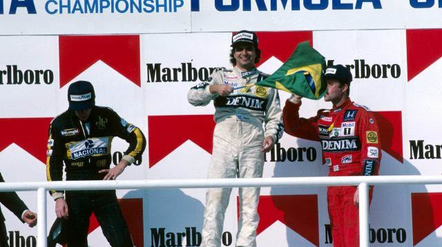 Podium and Results: first Nelson Piquet (BRA) Williams middle, second Ayrton Senna (BRA) Lotus left and third Nigel Mansell (GBR) Williams right.