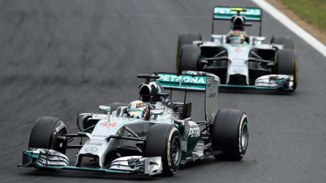 Lewis Hamilton (GBR) Mercedes AMG F1 W05 leads Nico Rosberg (GER) Mercedes AMG F1 W05. Formula One World Championship, Rd11, Hungarian Grand Prix, Race Day, Hungaroring, Hungary. Sunday 27 July 2014. &copy&#x3b; Sutton Motorsport Images