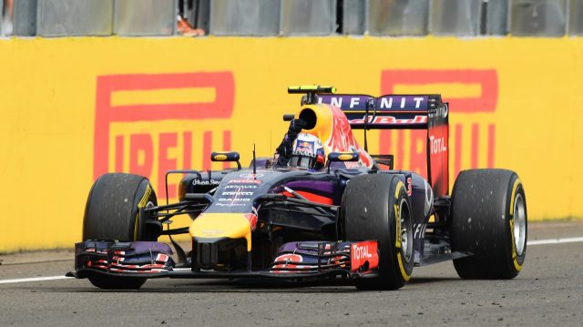 Race winner Daniel Ricciardo (AUS) Red Bull Racing RB10 crosses the line.