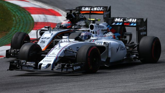 Valtteri Bottas (FIN) Williams FW37 and Nico Hulkenberg (GER) Force India VJM08 battle at Formula One World Championship, Rd8, Austrian Grand Prix, Race, Spielberg, Austria, Sunday 21 June 2015. &copy&#x3b; Sutton Motorsport Images