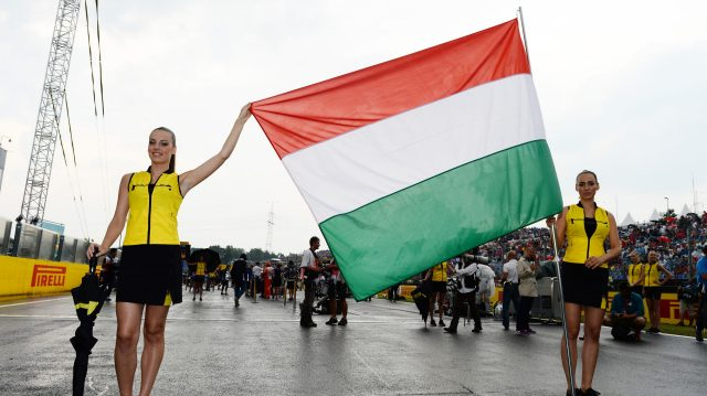 Grid girls with Hungarian flag on the grid.